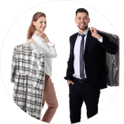man-and-woman-holding-dry-cleaning